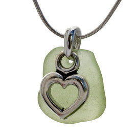 A smaller piece of natural pale olive green sea glass set on a solid sterling hand cast bail with a sterling silver heart charm. A perfect sea glass necklace for any sea glass lover!