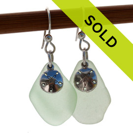 Genuine seafoam green beach found sea glass pieces combined with sterling silver sandollar charms for a lovely pair of sea glass earrings