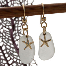 Perfect white sea glass earrings with gold starfish charms on french ear wires.