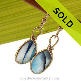 An ultra rare match of mixed English sea glass piece from Seaham England in our Original Gold Wire Bezel© sea glass earring setting. Sorry this one of a kind sea glass jewelry selection has been sold!