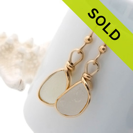 Sea Glass Earrings in white beach found sea glass. Set in our signature Original Wire Bezel in 14K goldfilled.
