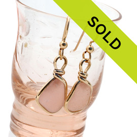 Beautiful peach sea glass pieces from a beach in Nova Scotia are set in our signature gold Original Wire Bezel© setting. Sorry this pair has been sold!