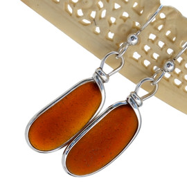 This glowing amber sea glass is set in sterling and left unaltered from the way it was found on the beach.
