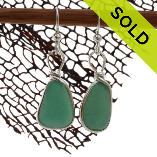 A very unusual deep aqua green sea glass pair set in our classic and elegant Original Wire Bezel setting. Sorry this Sea Glass Earring pair has been SOLD!