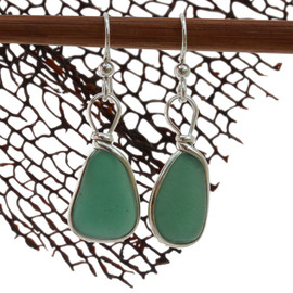 A very unusual deep aqua green sea glass pair set in our classic and elegant Original Wire Bezel setting. A great pair of sea glass earrings for any beach lover!