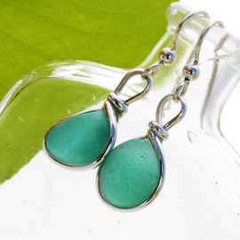 Vivid deep aqua sea glass from England is set in our Original Wire Bezel© setting for a stunning pair of earrings.  This is the EXACT pair of sea glass earrings you will receive!