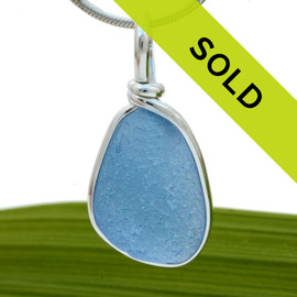 A beautiful very frosty piece of Carolina Blue sea glass set in our Original Wire Bezel© setting. A great sea glass pendant for any necklace.