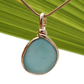 A stunning piece of gray blue sea glass set in our Original Wire Bezel© setting in 14K Rolled Gold. Much prettier in person!!!!