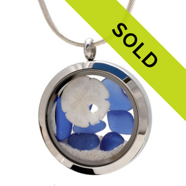 Blue beach found sea glass and a small sandollar in this one of a kind sea glass locket necklace.