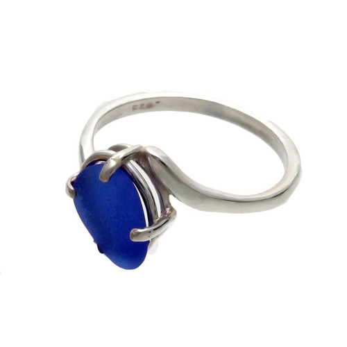 An unaltered blue sea glass piece set in a simple sterling ring.