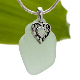 A perfect piece of LARGE Seafoam Green sea glass set on a solid sterling hand cast bail with a sterling silver charm. A perfect sea glass necklace for any sea glass lover!