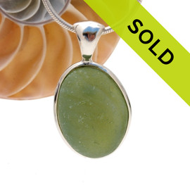 Ultra rare opalescent green sea glass in our Deluxe Wire Bezel setting. Sorry this sea glass jewelry piece has sold!