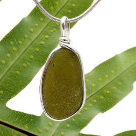 Our Original Sea Glass Bezel© 2000 setting really makes this glow! A perfect round piece of this jungle green sea glass in solid sterling Original Sea Glass Bezel© setting