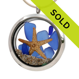 Genuine blue sea glass pieces combined with a starfish and real beach sand in this JUMBO 35MM stainless steel locket. Sorry this piece is no longer for sale.