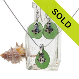 Bright green sea glass in a silver set of earring and matching pendant with silver sea turtle charms. Sorry this set is no longer for sale...
