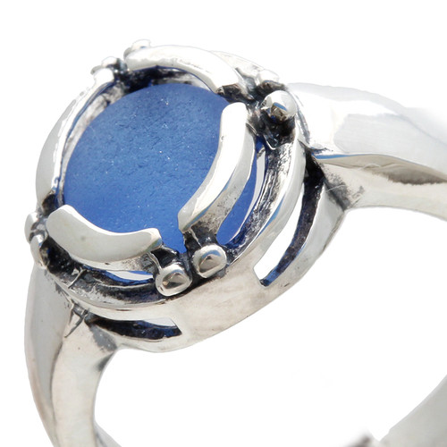 A perfect piece of medium blue sea glass in a back set signet ring setting.