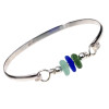 Three pieces of beach found sea glass in vivid green and a rich cobalt blue and seafoam on this solid sterling silver half round sea glass bangle bracelet.