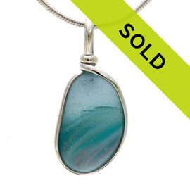 An amazing combination of vivid mixed medium blue and subtle pink in this very old English Sea Glass piece and set in our Original Wire Bezel© necklace pendant setting. Sorry this special sea glass pendant has sold!