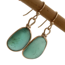 A mixture of sea green tones in this Victorian era sea glass earring pair. Unique and special!