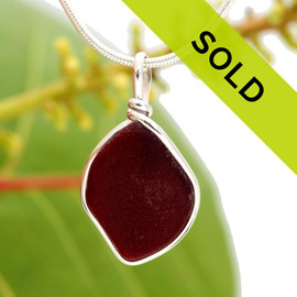 Deep ruby red sea glass from Puerto Rico is set in our Original Wire Bezel Setting in silver. Sorry this jewelry piece has been sold!