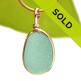 A perfect piece of aqua green with in our signature Original Wire Bezel© pendant setting that leaves both front and back open and the glass unaltered from the way it was found on the beach. Sorry this piece is no longer available!