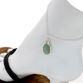 Solid sterling silver anklet with a bezel set green sea glass piece