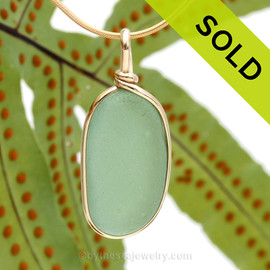 A nice piece of bright glowing seafoam or aqua green with in our signature Original Wire Bezel© pendant setting that leaves both front and back open and the glass unaltered from the way it was found on the beach.
