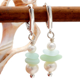 Beautiful double green sea glass set on sterling silver with AAA grade fresh water pearls. This pair comes on top grade sterling leverbacks for pierced ears.
