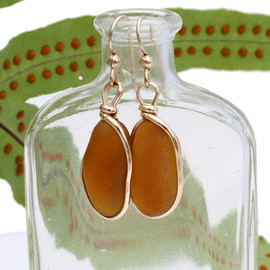 Longer and larger pieces of natural amber brown sea glass set in our Original Wire Bezel© setting in gold