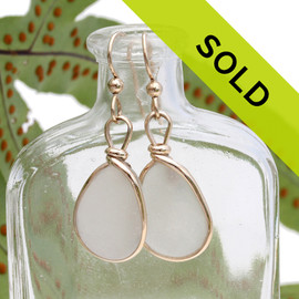 Perfect and natural UNALTERED white sea glass set in our Original Wire Bezel© setting. Sorry this pair has sold!