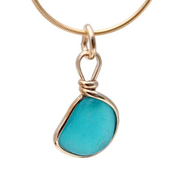 Electric Aqua sea glass set in a 14K Goldfilled Original Wire© bezel. Great for any charm bracelet or can be converted to a pendant or anklet. Can also be worn as a pendant as is!