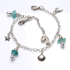 3 pieces of genuine beach found sea glass in a a vivid aqua combined silver charms a totally solid sterling silver bracelet.