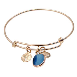A nice piece of mixed aqua and blue sea glass combined with goldfilled charms on this adjustable goldfilled bangle bracelet. The sea glass is beach found and tumbled only by tide and time found on the beaches of Seaham England and set in a 14K Goldfilled cinch bail