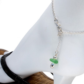 A simple green sea glass anklet for your beach trips this summer.  Solid Sterling starfish charm and a delicate long and short chain with soldered utility links ensure this piece will remain with you always!