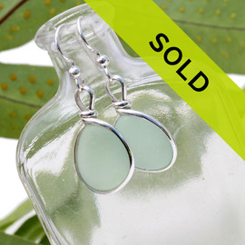 Our jewelry leaves our sea glass totally natural, just the way it was found on the beach. We use ONLY Genuine sea glass collected on beaches from around the world.  This pair of seafoam green sea glass earrings is set in our signature and original Wire Bezel© setting. Sorry this pair of earrings has been sold!