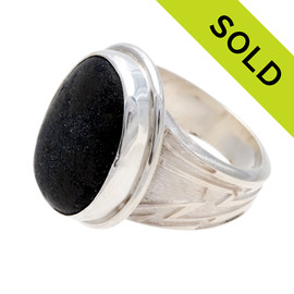 A stunning piece of black sea glass from Seaham England and the site of Victorian era glass factories is set in a solid sterling silver and fine silver bezel set ring. SOLD - Sorry This Sea Glass Ring Is NO LONGER AVAILABLE!