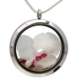 Pure white sea glass combined with a baby sandollar and beach sand in this twist top stainless steel locket necklace.  Pink Tourmaline gem beads make this a great gift for anyone with an October Birthday!  Also great gift idea for any cancer survivor.