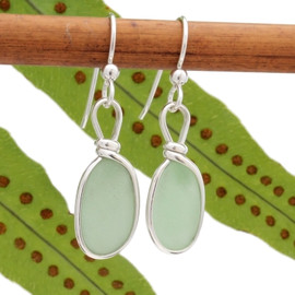 Our jewelry leaves our sea glass totally natural, just the way it was found on the beach. We use ONLY Genuine sea glass collected on beaches from around the world.  This pair of seafoam green sea glass earrings is set in our signature and original Wire Bezel© setting.