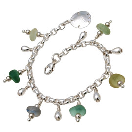 6 pieces of genuine beach found sea glass in a range of colors on a totally solid sterling silver bracelet finished with a sterling sandollar charm.  Perfect for any sea glass lover.