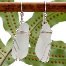 Authentic Genuine Sea Glass in a triple sterling setting that maximizes the bling of silver yet leaves most of the white sea glass open to glow.