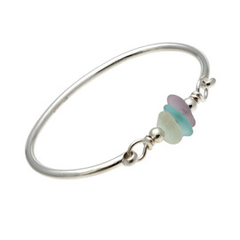 Three pieces of beach found sea glass in yellow, aqua and lavender on this solid sterling silver half round sea glass bangle bracelet.