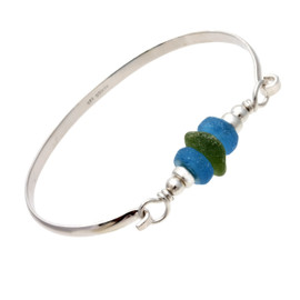 A green beach found sea glass seaweed green sandwiched between two bright blue recycled glass beads on this solid sterling silver half round sea glass bangle bracelet.
