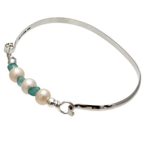 Three aqua sea glass pieces from Hawaii are combined with genuine fresh water pearls on a solid sterling bangle bracelet.