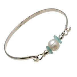 Two aqua sea glass pieces from Hawaii are combined with genuine a fresh water pearl on a solid sterling bangle bracelet.