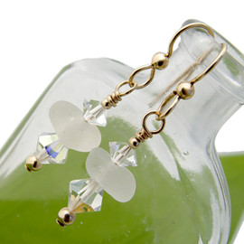 Perfect white sea glass pieces set with vintage crystals and goldfilled details in this lovely pair of sea glass earrings.