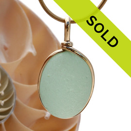 A nice piece of sea green or seafoam green sea glass with in our signature Original Wire Bezel© pendant setting that leaves both front and back open and the glass unaltered from the way it was found on the beach.