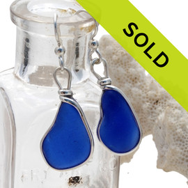 Thick beach found cobalt blue sea glass set in our signature Original Wire Bezel Setting©  This is the EXACT pair you will receive!