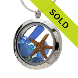 Real beach found blue sea glass and a real starfish in this Stainless steel locket. Blue Topaz and zircon birthstones makes this a great gift for any December Birthday