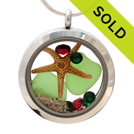 Green sea glass and vivid ruby red and green gemstones make this a great locket necklace for the holidays.