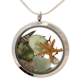 Genuine peridot or olive green and seafoam sea glass piece combined with a real shells, sea fan, starifhs and a real beach sand in this JUMBO 35MM stainless steel locket.